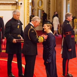 Receiving a Damehood from HRH Prince of Wales, for services to music
