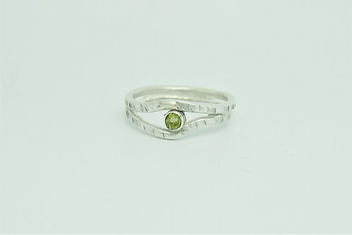 Textured ring with gemstone