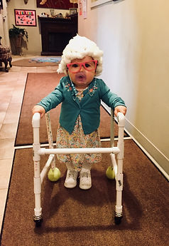 Toddler dressed up as an elderly lady