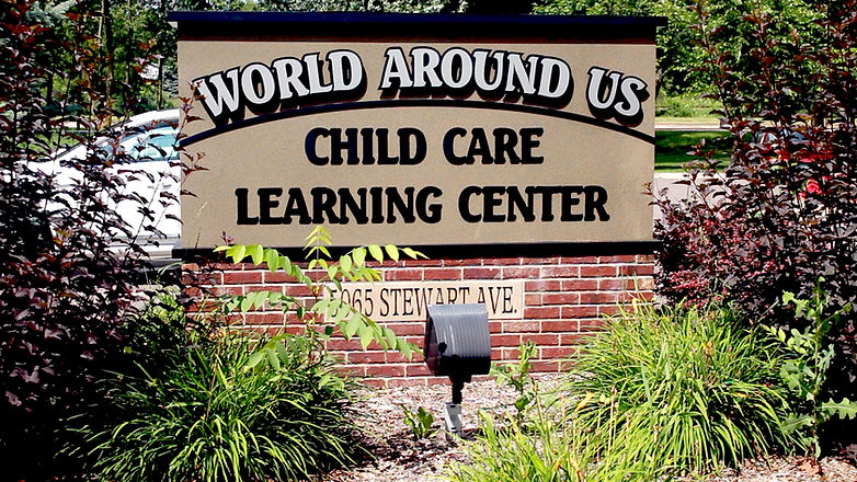 World Around Us Child Care Sign outside White Bear Lake Location