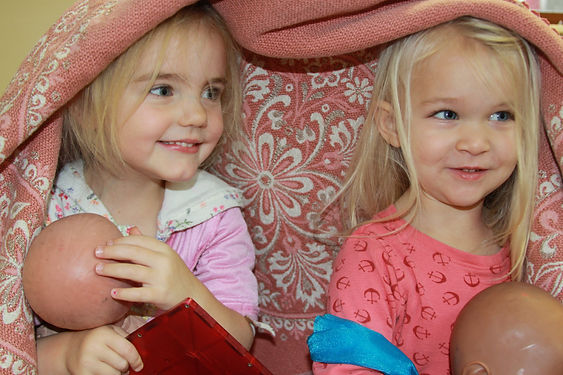 Two Preschoolers playing in th preschool room
