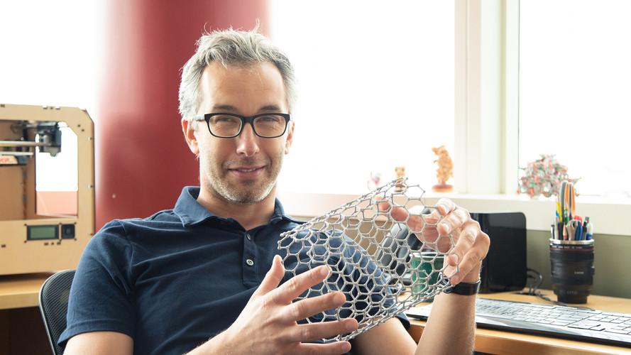 Ognjen with a 3D model of a carbon nanotube produced by CHEM6353 students