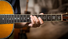 Hand shown on Jimmie Rodgers fretboard guitar