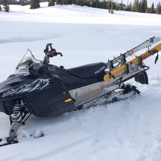 Snowmobile rigged for action