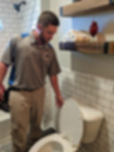 inspecting the bathroom plumbing