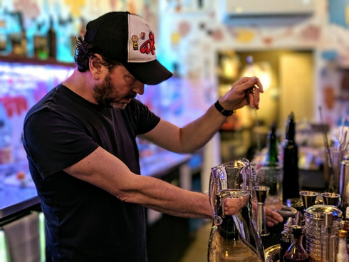 Chris mixing a drink
