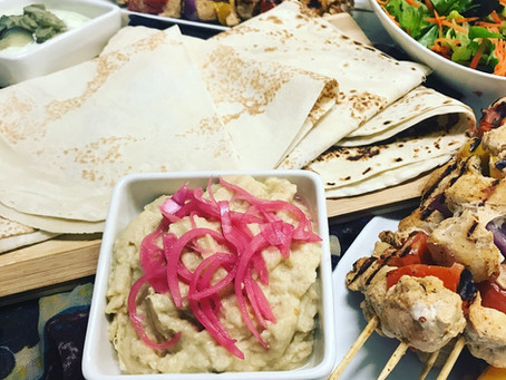 Chicken Taouk Skewers, Side Salad, Baba Gannoush with Pickled Onions, Yoghurt and Mint with Gherkins