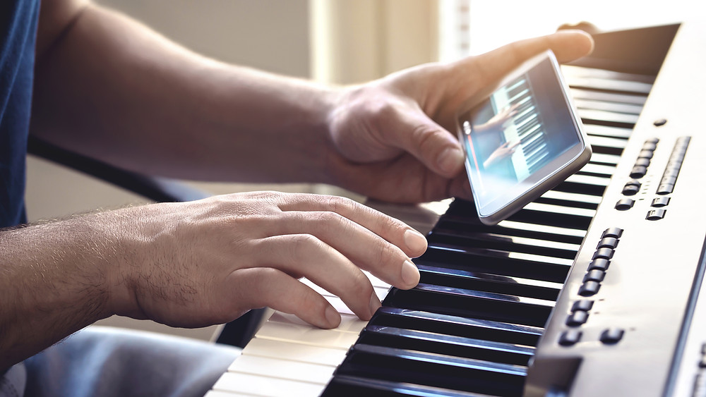 a person learning piano from a piano app