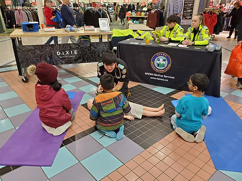 NPEMA MedVent Ethan providing CPR training at a Dixie Outlet Mall CPR-month event.