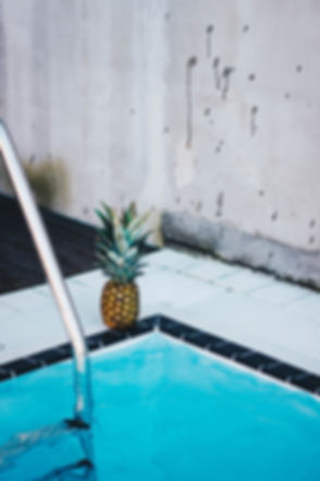 Canva - Pineapple Beside the Swimming Po