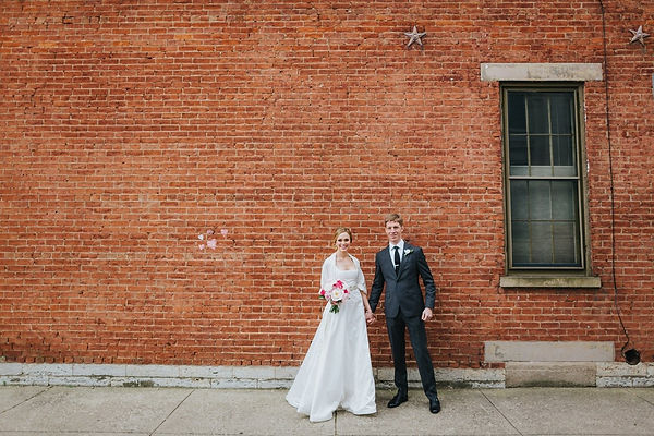 brick wall couple.jpg