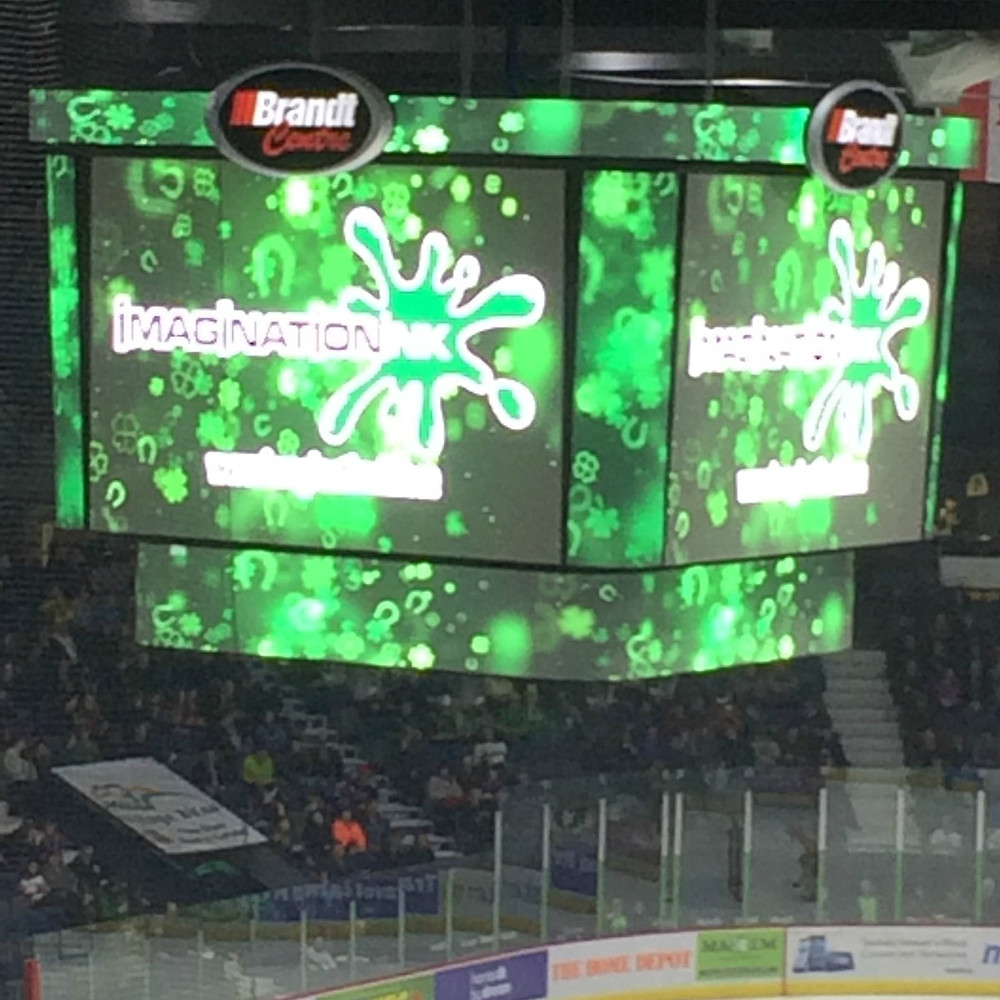 Regina Pats - Imagination Ink scoreboard ad