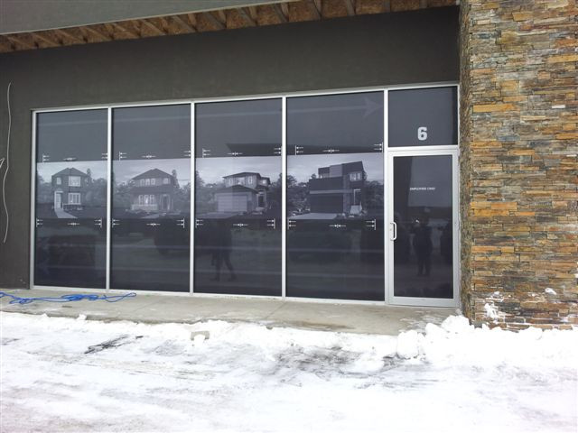 Artisan Design Build - perforated vinyl window graphics.