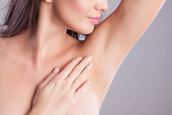 Close up of female armpit. Model touchin