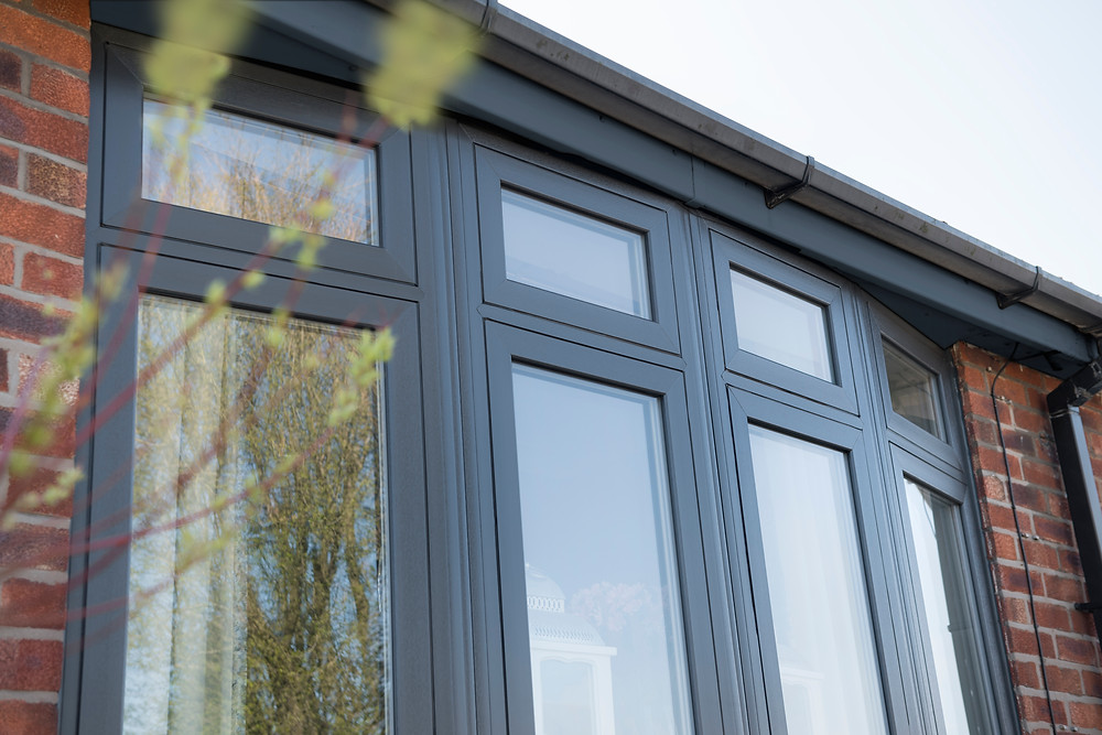 UPVC Double Glazed flush casement windows painted in anthracite grey with a smooth texture