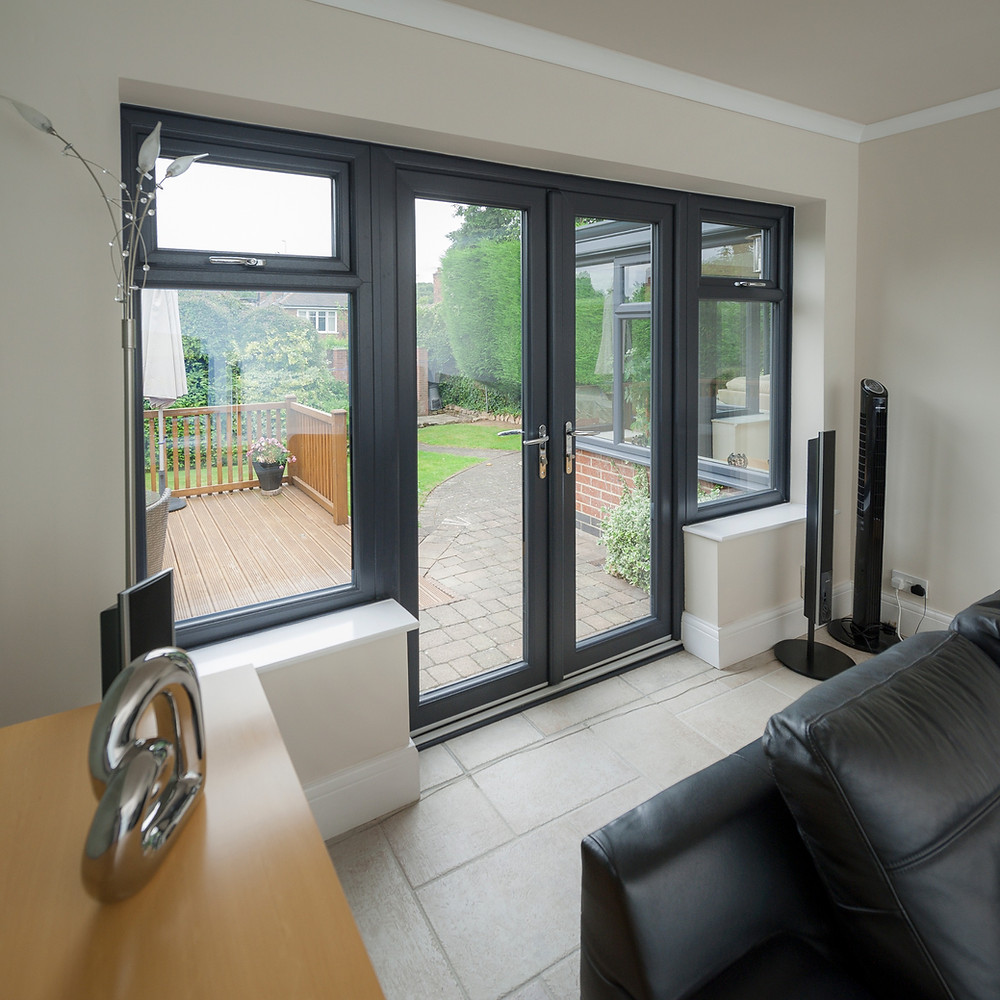 UPVC Double Glazed french doors with large side windows with top openers painted in anthracite grey