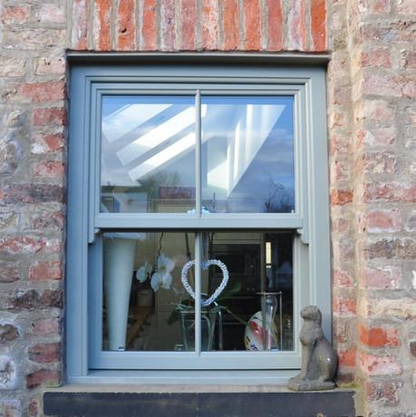 Grey sliding sash window