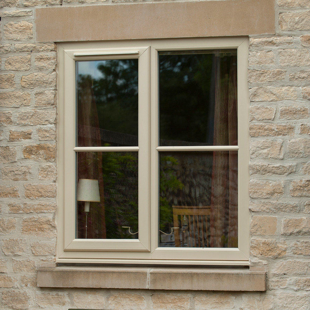 A UPVC Double Glazed casement window featuring a side opener and glazing bars painted in cream