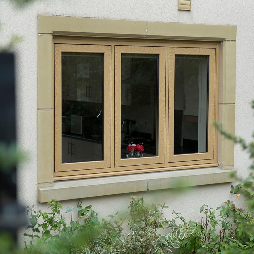 A 3 pane UPVC Double glazed flush casement window finished in golden oak