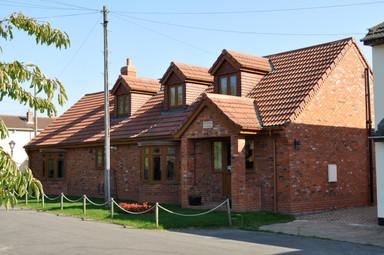 Red Brick with Golden Oak Windows