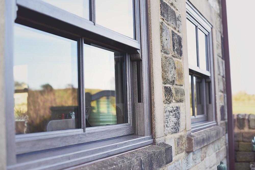 UPVC Double Glazed sliding sash windows finished in living oak