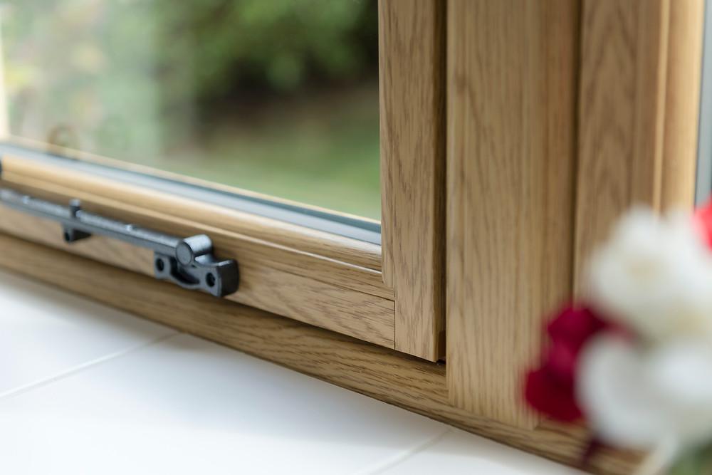 A internal shot of a upvc double glazed flush casement window finished in golden oak