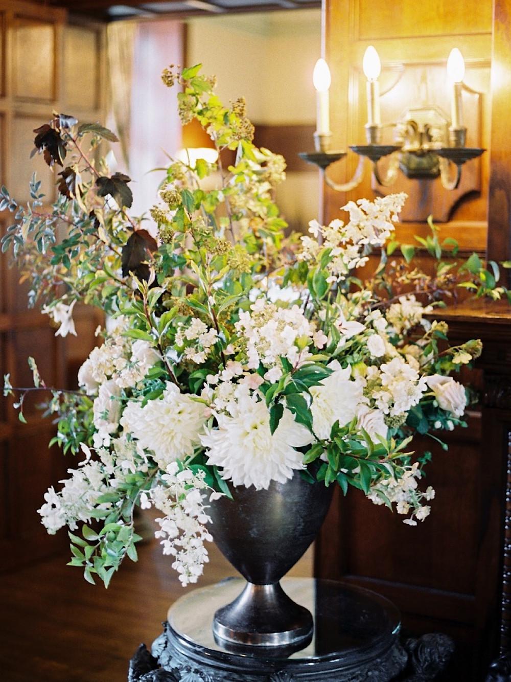 Romantic vase arrangement accents the rich wood interior of Thornewood Castle | Seattle Wedding Florist Botanique