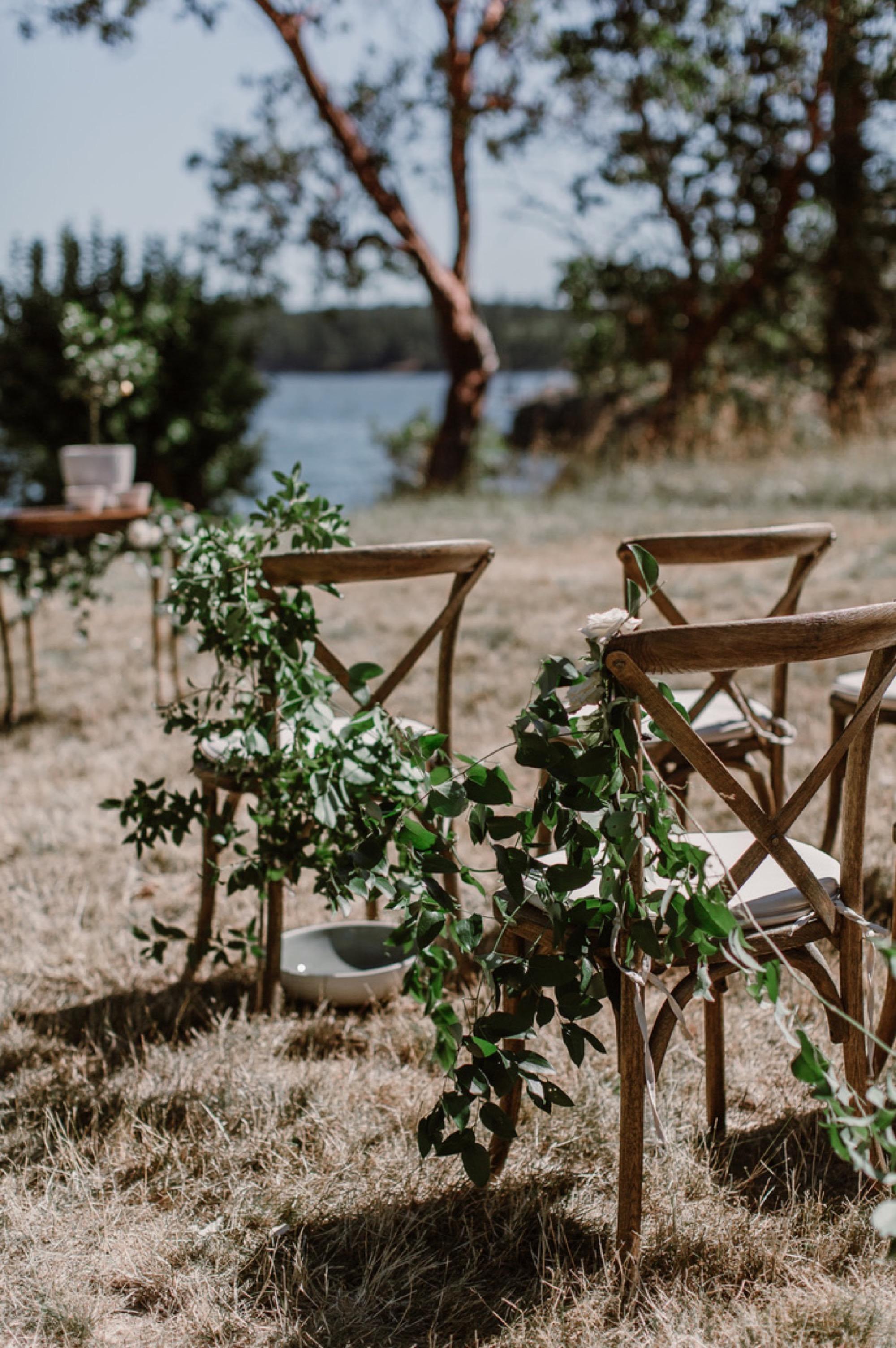 Greenery chair decor at a Pebble Cove Farm Wedding