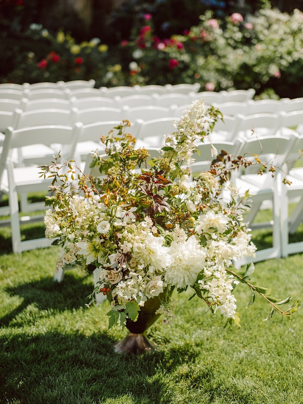 Lush wedding ceremony florals at Thornewood Castle