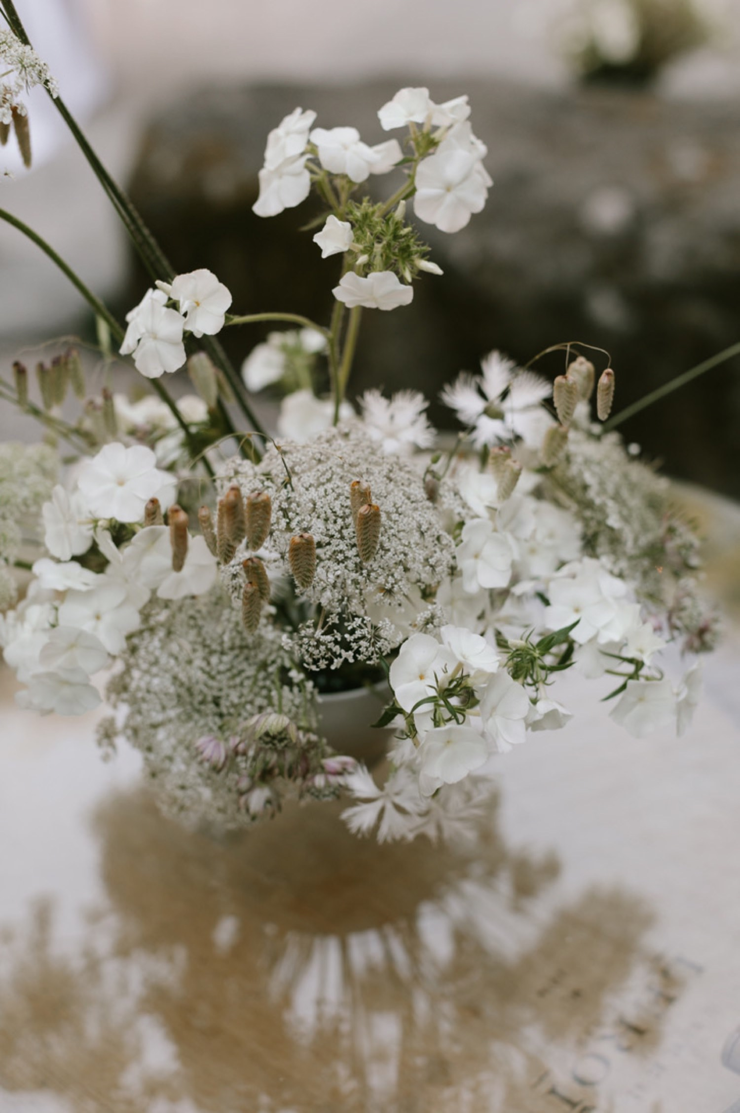 Delicate and minimal all white wedding florals from Botanique Flowers Seattle