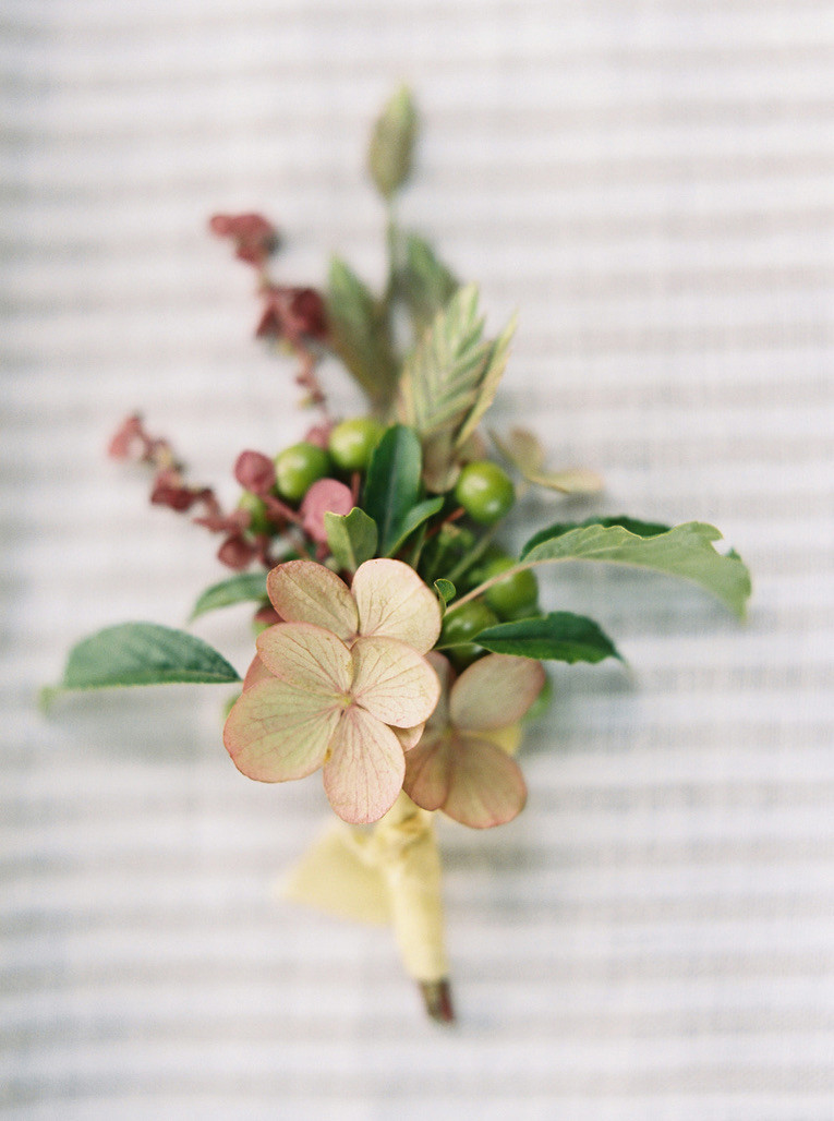 Colorful, summer boutonniere with silk ribbon and peachy golden tones for a Bainbridge Island wedding- flower by Botanique- a Seattle florist specializing in elegant, seasonal, lush wedding floral design
