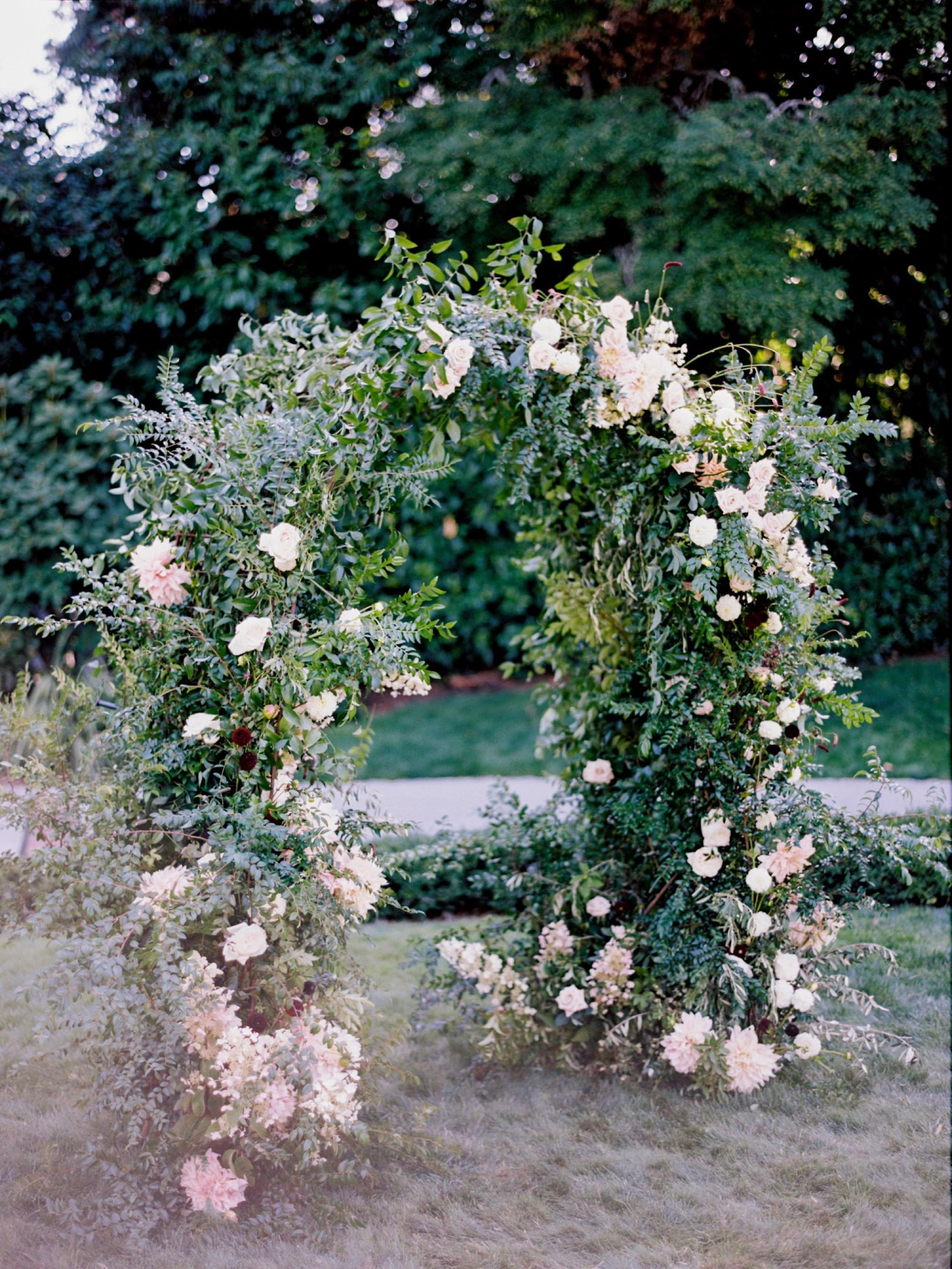 Lush ceremony floral arch from top Seattle Wedding florist Botanique
