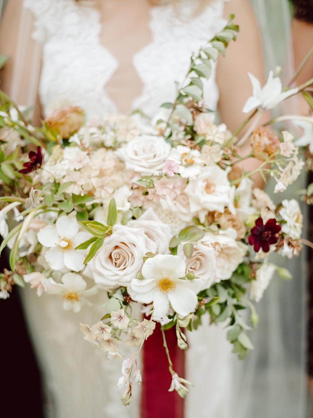 Garden inspired bridal bouquet from Seattle Wedding Florist Botanique at a Thornewood Castle Wedding