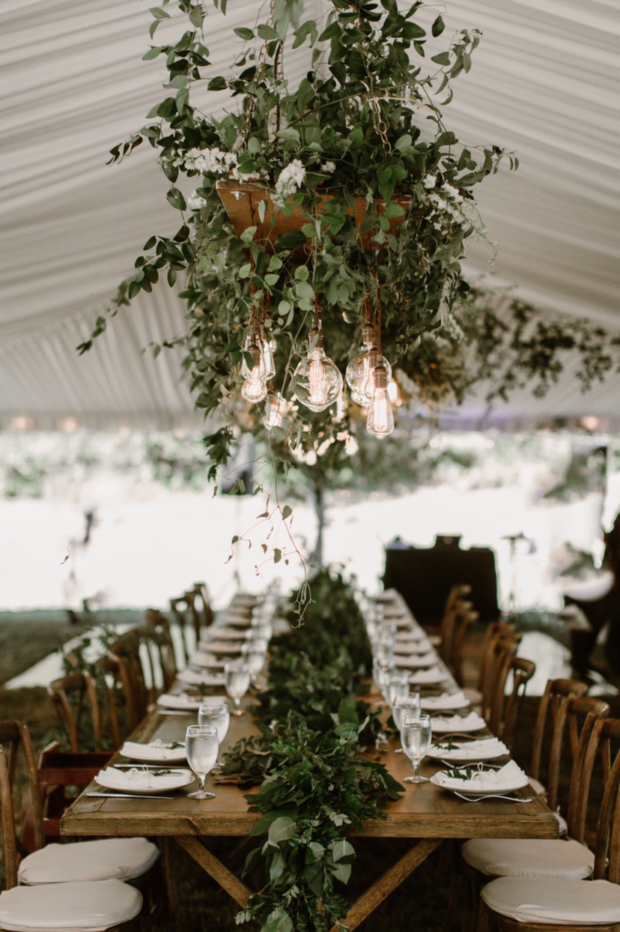 Greenery and vintage lightbulb create a romantic atmosphere