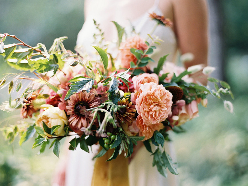 Colorful, organic, summer bridal bouquet with trailing ribbons and peachy golden tones for a Bainbridge Island wedding- flower by Botanique- a Seattle florist specializing in elegant, seasonal, lush wedding floral design