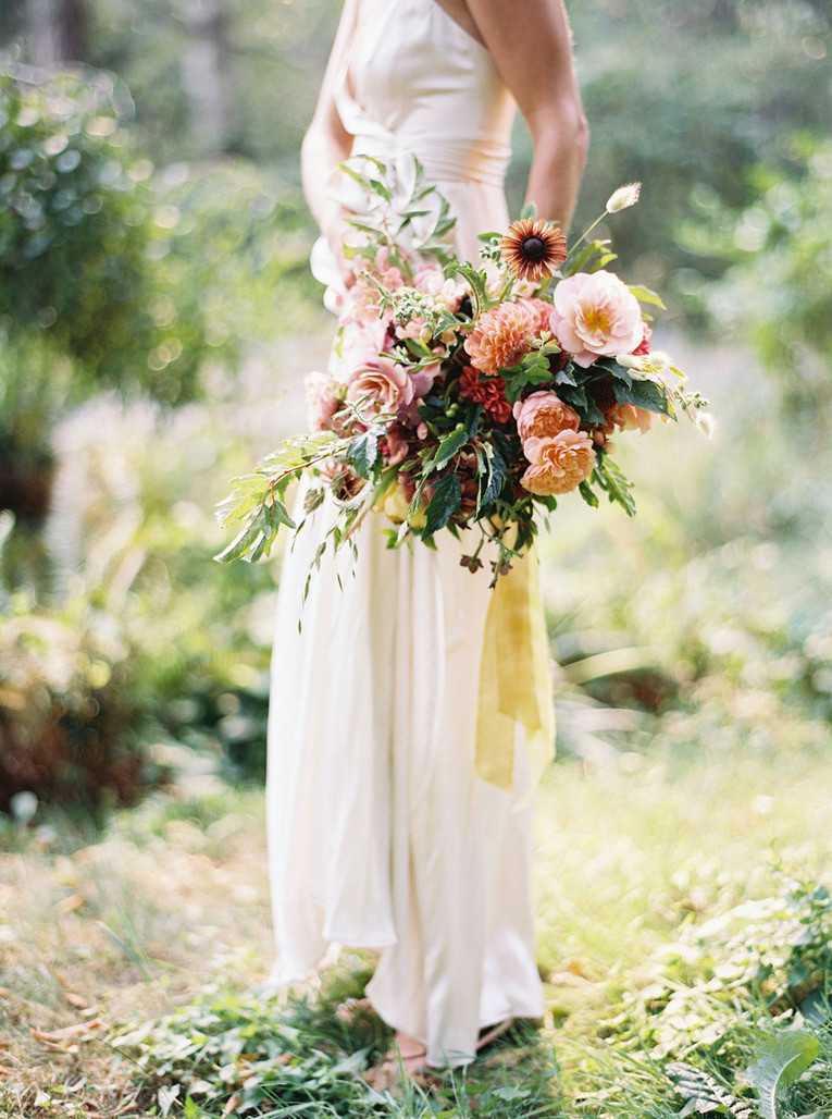 Colorful, organic bridal bouquet with trailing ribbons and peachy golden tones for a Bainbridge Island wedding- flower by Botanique- a Seattle florist specializing in elegant, seasonal, lush wedding floral design