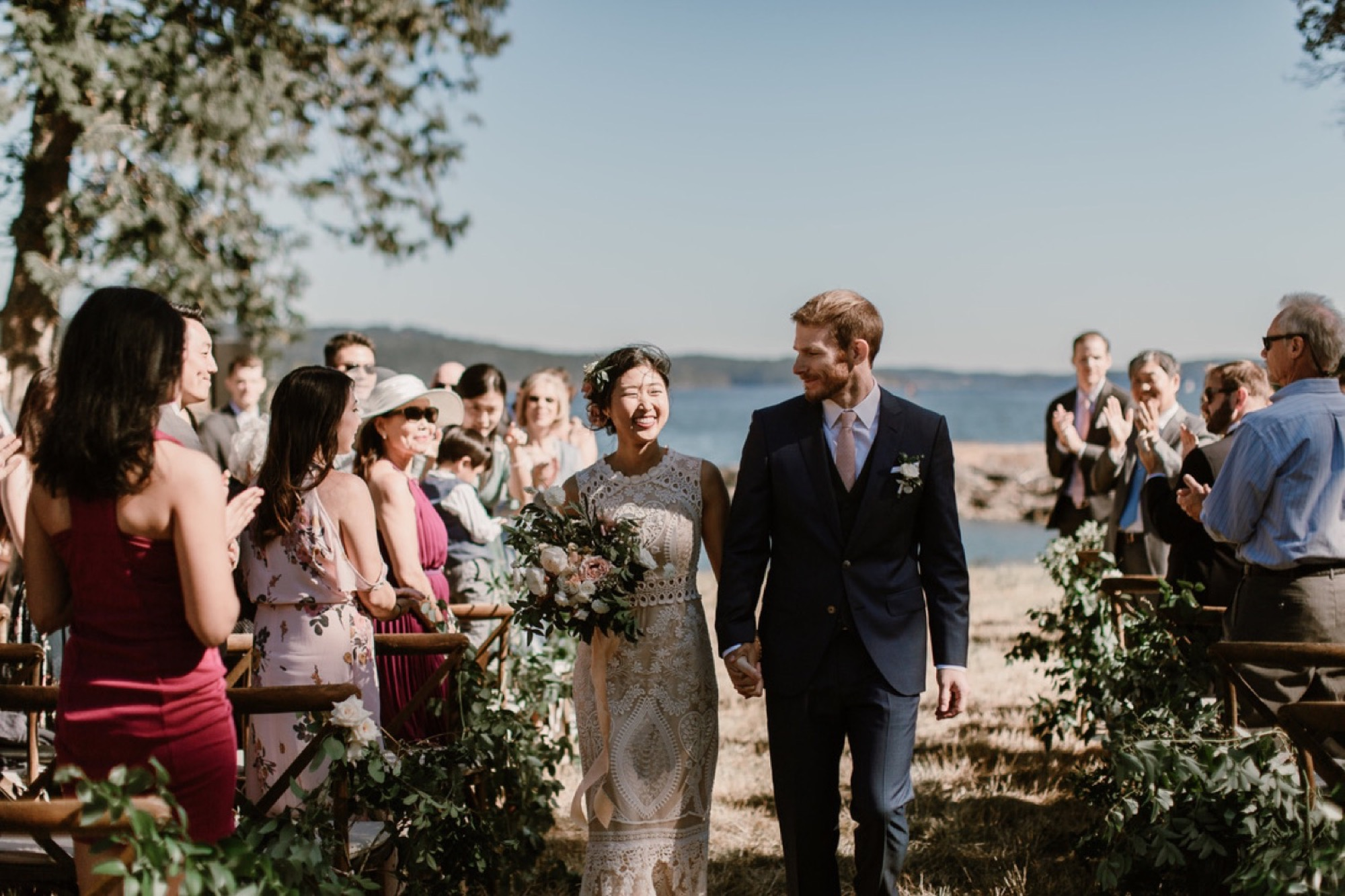 Bride and groom exit their ceremony at Pebble Cove Farm