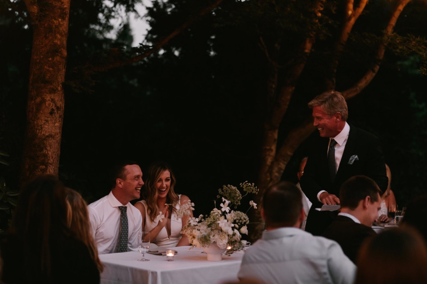 A candid toast moment at JM Cellars with Seattle Wedding Florist Botanique