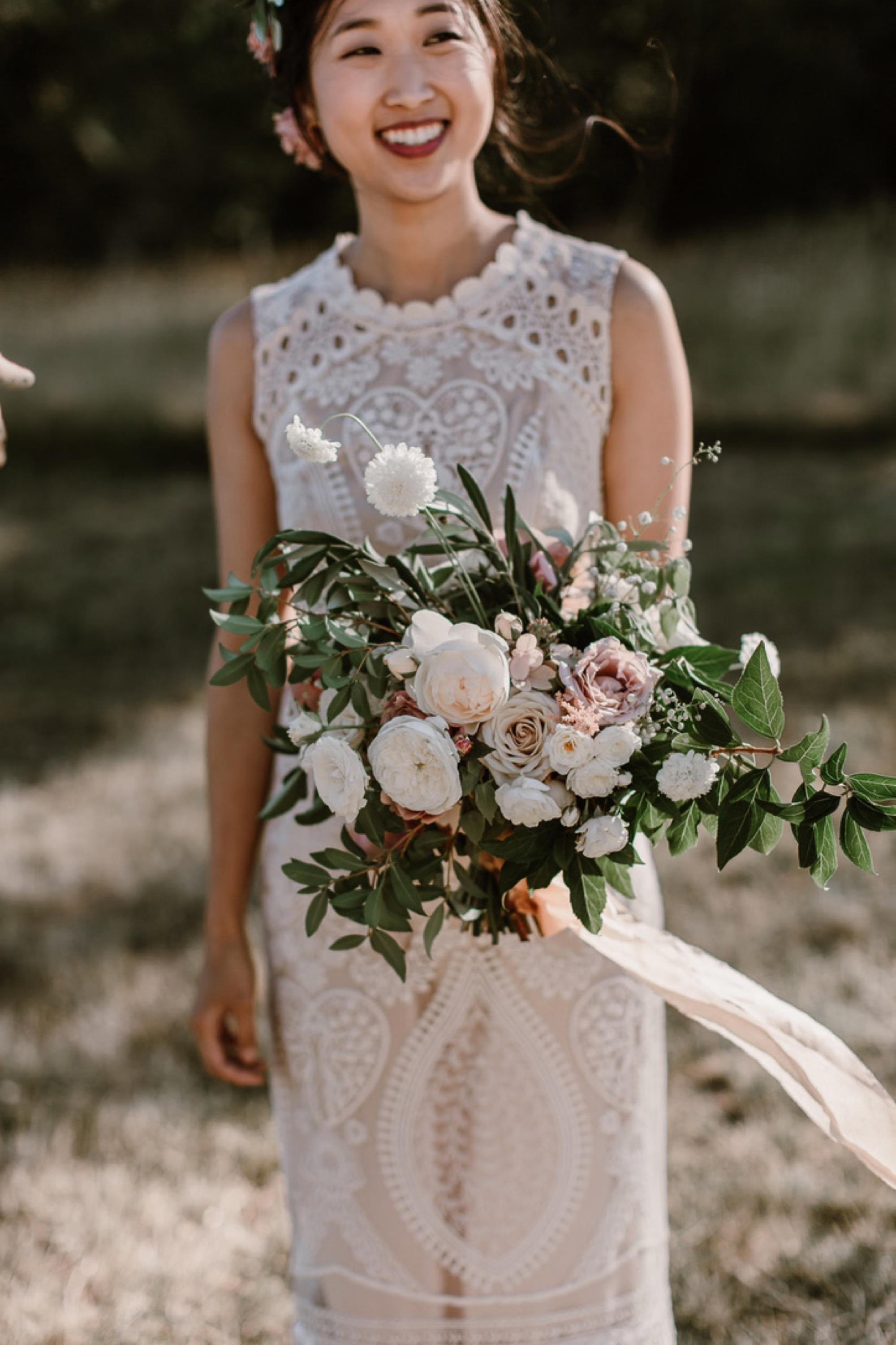 Bride holds her bouquet at a Pebble Cove Farm wedding on Orcas Island