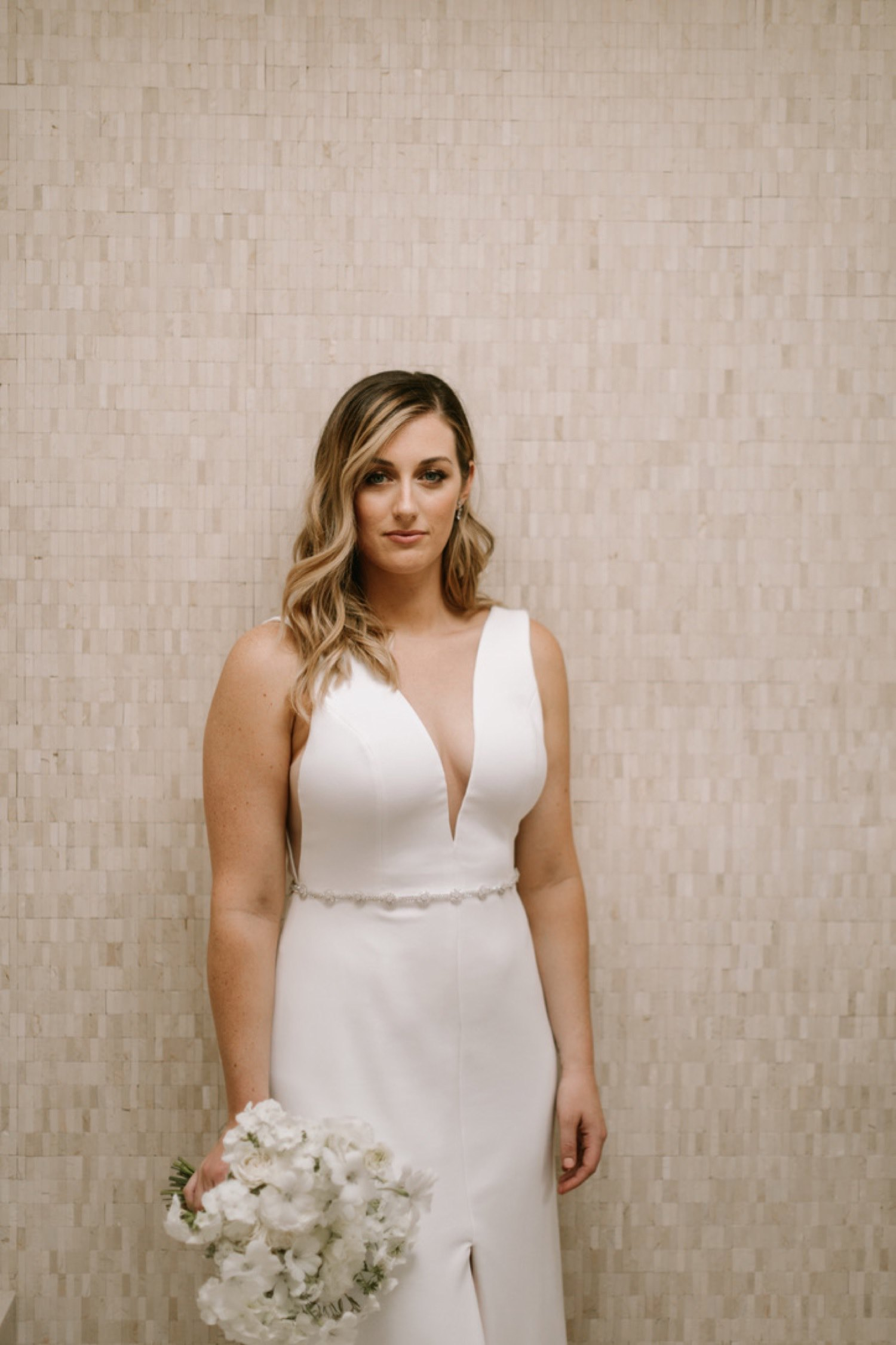 Chic bridal style with an all white bouquet at JM Cellars in Woodinville, WA