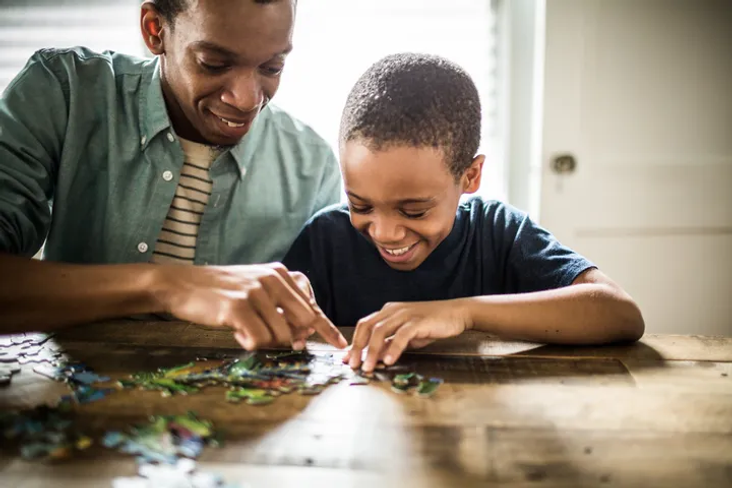 man and child puzzling.webp