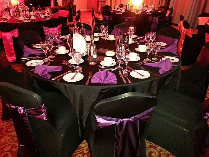 Black and purple event theming for weddings and parties.