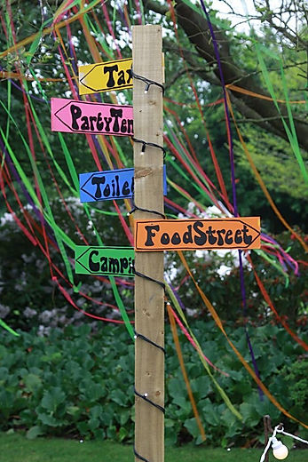 colourful sign posts for festival themed events.