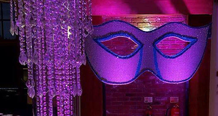 Purple masquerade venue props for hire. Hire Venitian masks as room decorations at your next themed function.