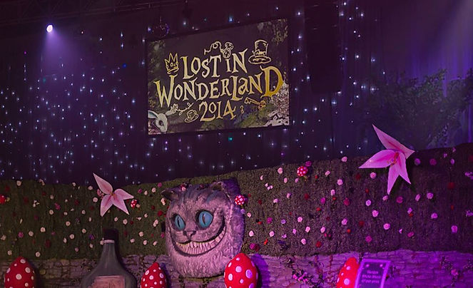 Alice in wonderland props and venue transformations for themed parties.