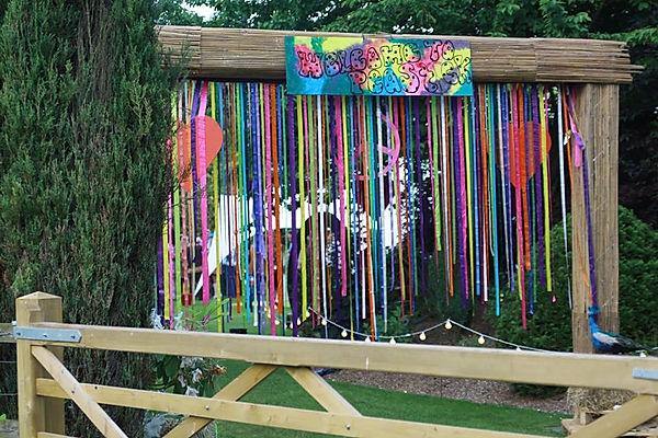 Archway decorations for festivals and parties near London. Hire festival enterances for your next summer party.