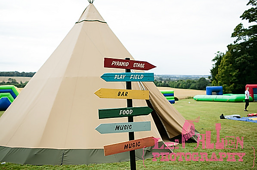 Colourful wedding signs and decorations for summer wedding events.