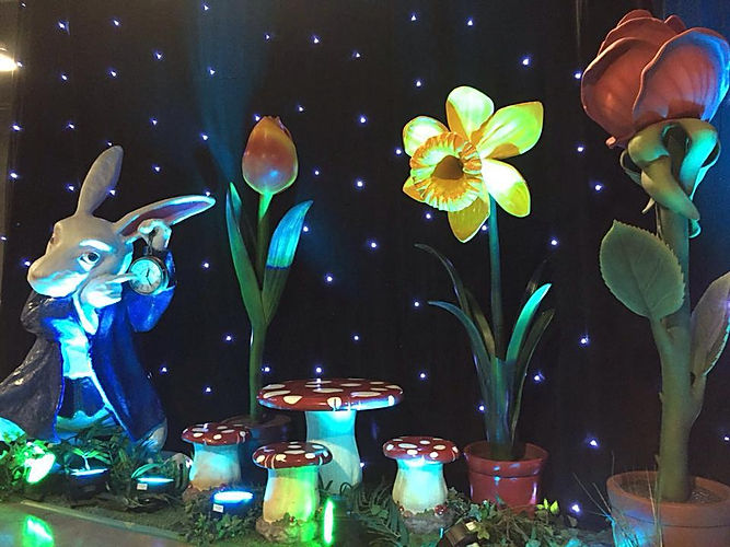 Alice in wonderland themed family fun day decorations.