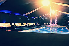 Marquee party built around a swimming po