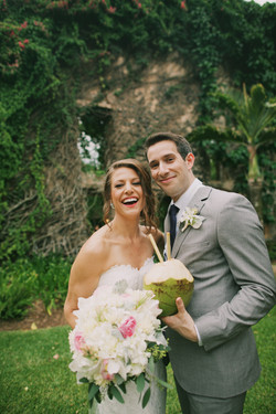 Maui bride and groom with coconut